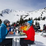 Group of skiers eating lunch at Crystal Mountain Resort