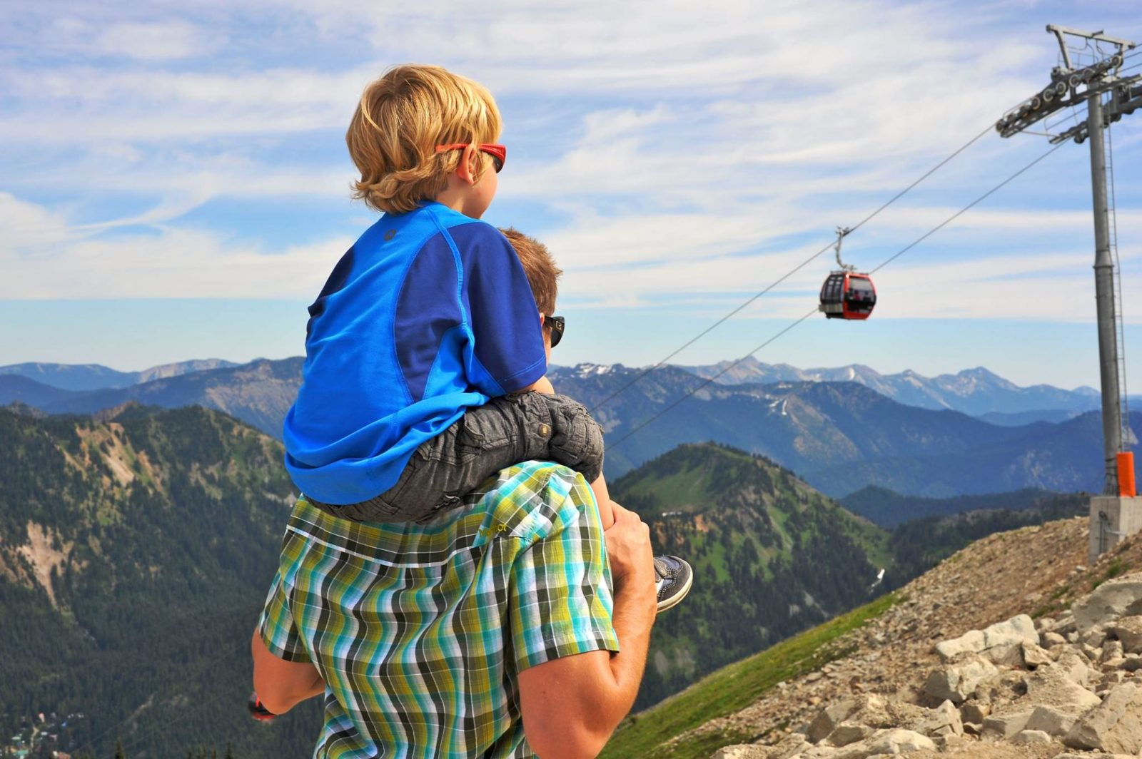 Father and son watch gondola