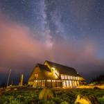 Stars above lit building