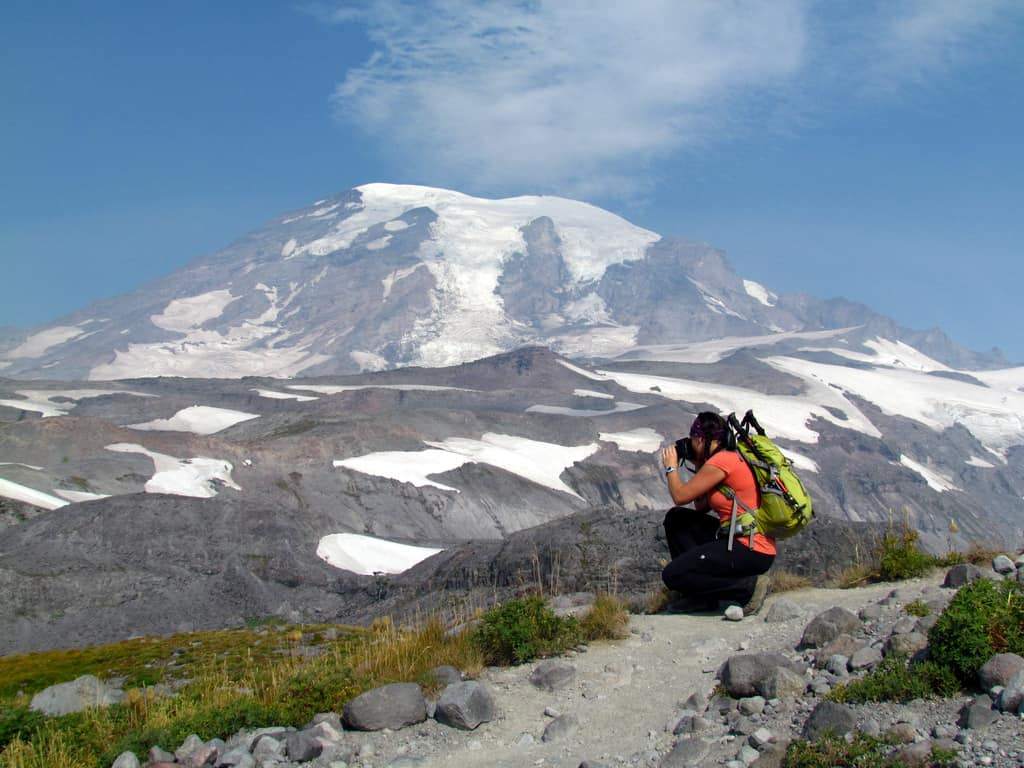 Woman photographing Mt Rainier