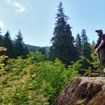 Hiker standing on Glacier Lake Trail
