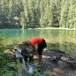 A hiker takes a break at Lake West