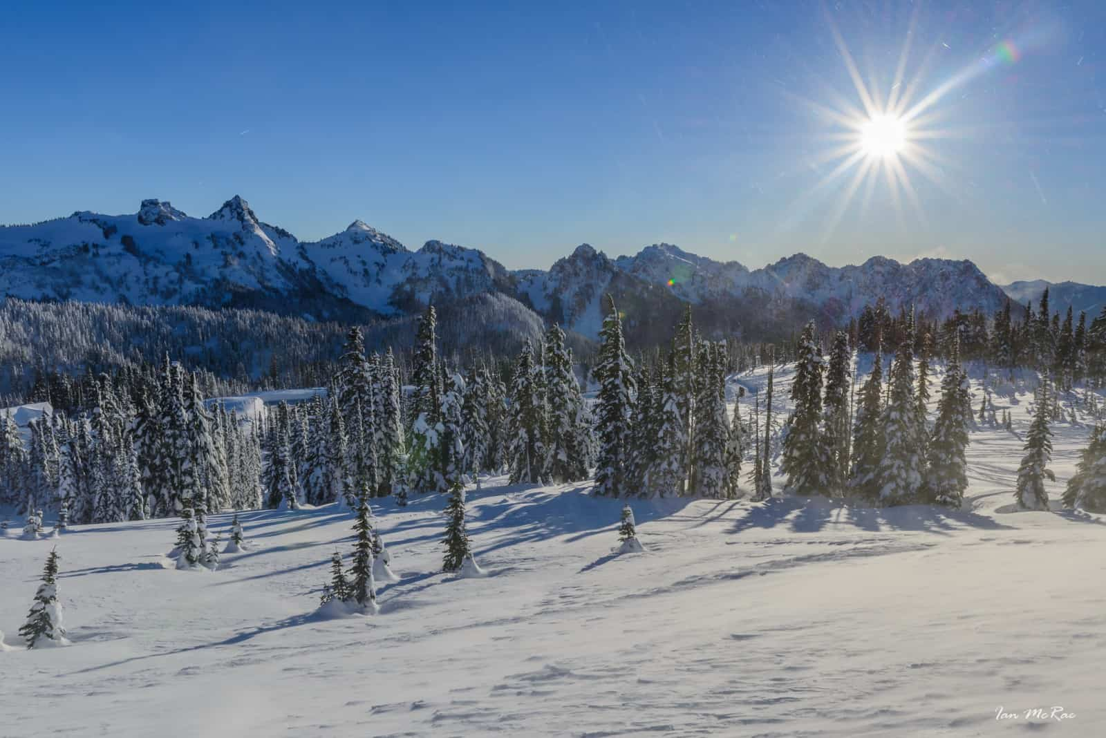 Snow covered landscape and mountain range