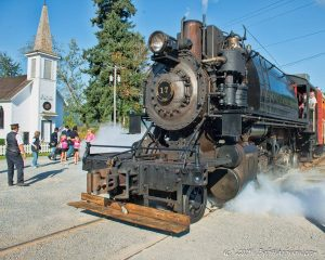 Steam train and little white church in Elbe Washington