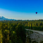 Hot air balloon with Mt. Rainier