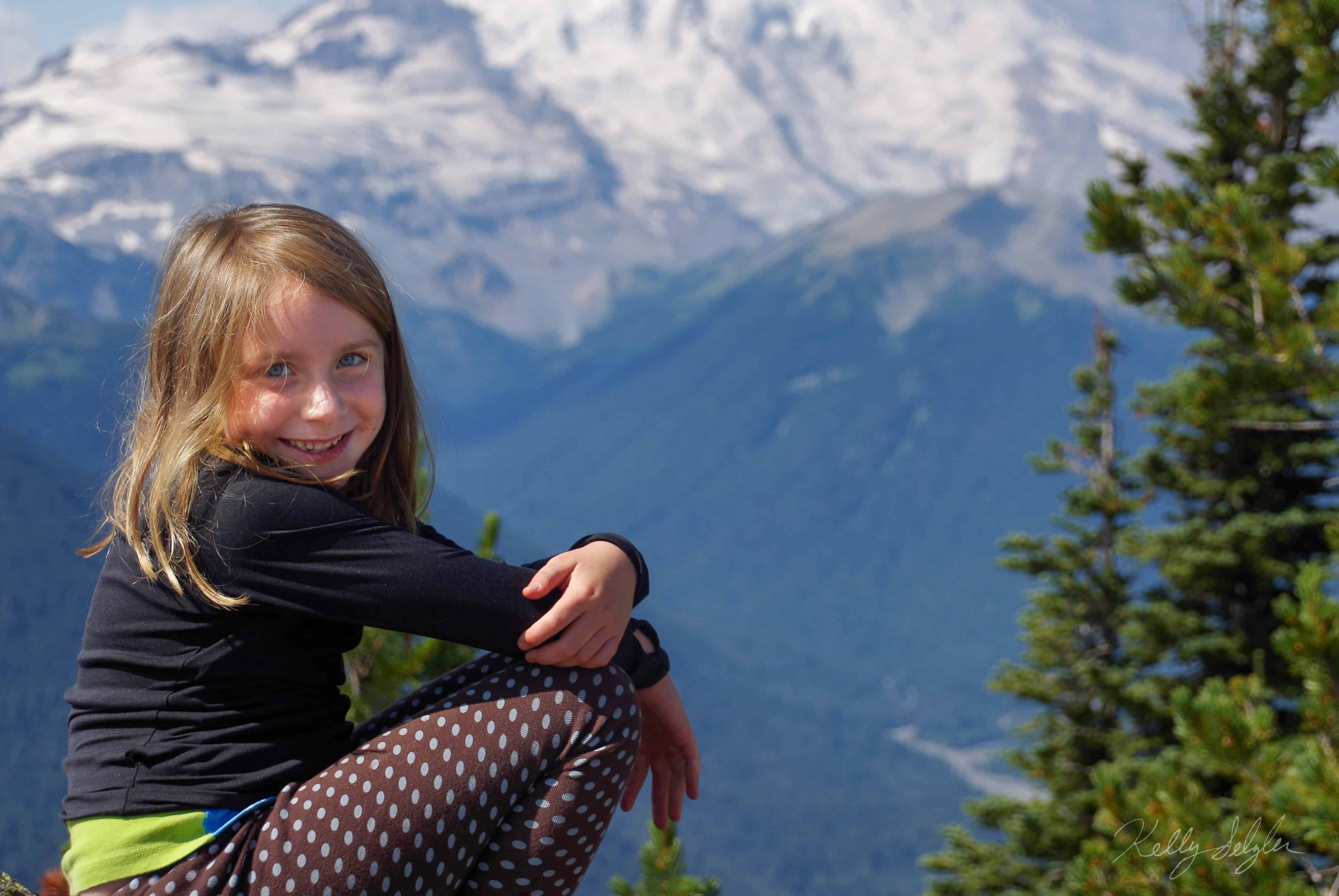 Happy Girl with Mountain Backdrop