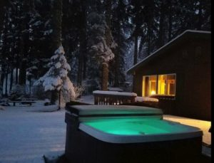 Spend a Cozy Night River House in winter with outdoor hot tub