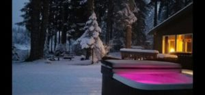 Lighted winter hottub outside The River House