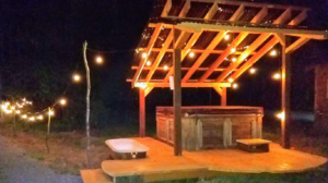 Happy Tails Cabin hot tub at night