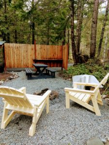 Happy Tails Cabin outdoor chairs and picnic table