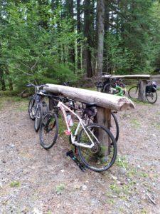 Bikes resting on log racks at Carbon River Road