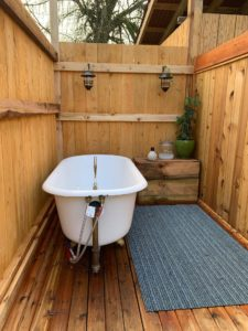 Outdoor bathroom at Red Cabin at Left Foot Farm