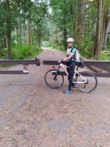 Woman biking the Carbon River Road