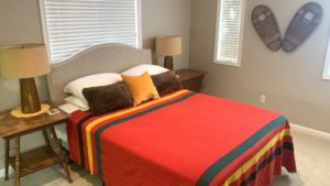 Guest room with queen size bed and nightstands